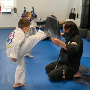 5 year old students practicing warm up kicks